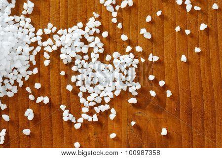 Coarse grained salt on wooden table
