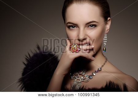 High-fashion Model Girl Beauty Woman high fashion Vogue Style Portrait beautiful fashionable Luxury lady precious jewelry diamond ring necklace earrings Stylish Perfect skin  lips passion aggression poster