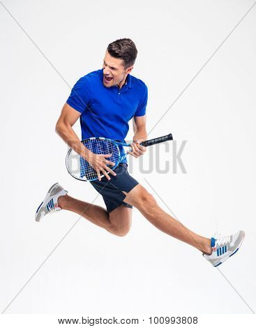 Portrait of a funny tennis player isolated on aw hite background