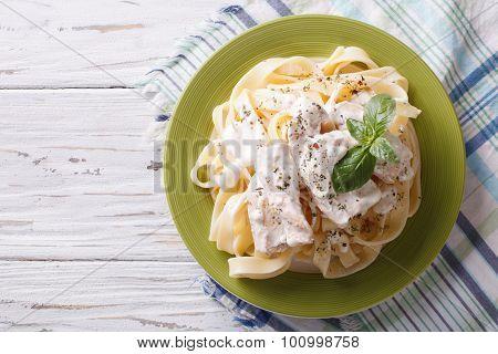 Alfredo Pasta In Cream Sauce With Chicken. Horizontal  Top View