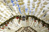Flower festival in Campo Maior with paper flowers decorared streets Portugal poster