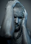 Horror, medieval executioner mesh iron rings on the head poster
