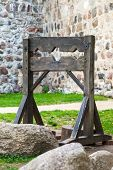 Old wooden medieval torture device. Ancient pillory. poster