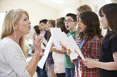 Children In Singing Group Being Encouraged By Teacher poster