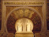 Mihrab arch indicating the qibla (direction of Mecca) in the Mezquita, the old Mosque, in Cordoba, Spain poster