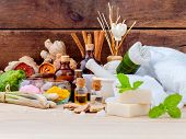 Natural Spa Ingredients Aromatherapy and Natural Spa theme on wooden background. poster