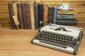 Travel typewriter on the desk of the writer. The writer writes a novel. Still life when writing stories. poster