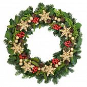 Christmas wreath with gold snowflake and bauble decorations, holly, ivy, mistletoe and winter greenery over white  background. poster