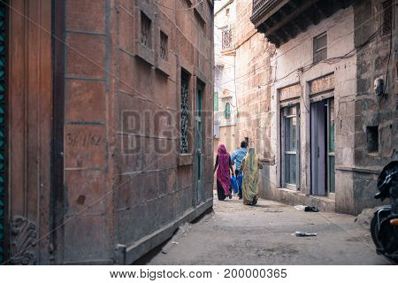 JODHPUR RAJASTHAN INDIA - MARCH 04 2016: Horizontal picture of indian local people dressing colorful clothes in Jodhpur the blue city of Rajasthan in India.