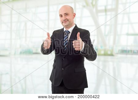 happy business man going thumbs up, at the office