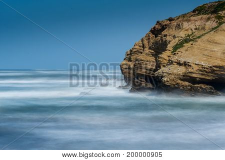 Blurred Motion Of Pacific Rocky Coast