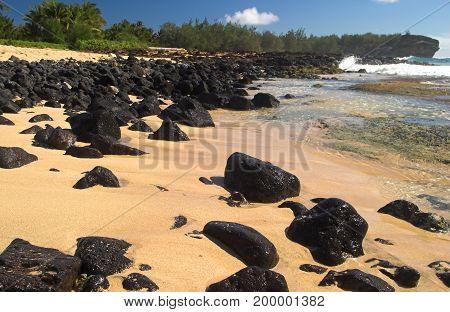 Shipwreck Beach With Balck Volcanic Boulders, Kauai