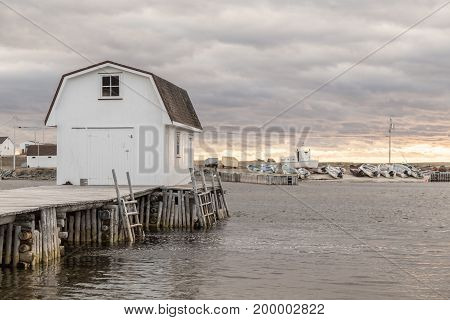 Boathouse On Dock At Sunset