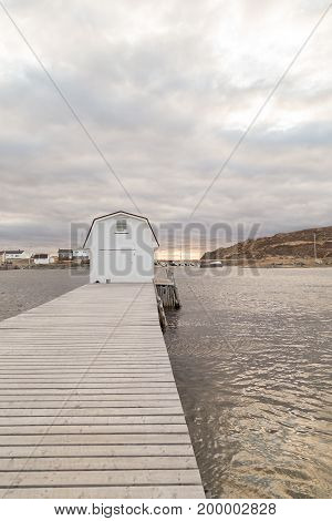 Long Dock With Boathouse At End