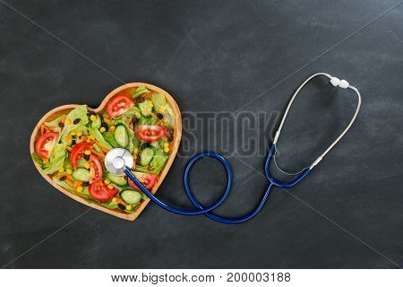 Medical Stethoscope Touching Fresh Healthy Food