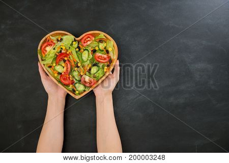 Beautiful Hands Holding Heart Shaped Wooden Plate