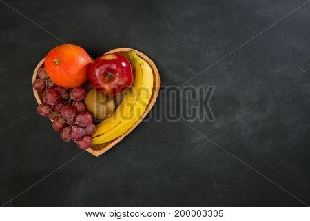 Juicy Fruits Set In Wooden Heart Shaped Plate
