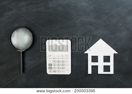 Magnifier And Calculator With Paper House Model