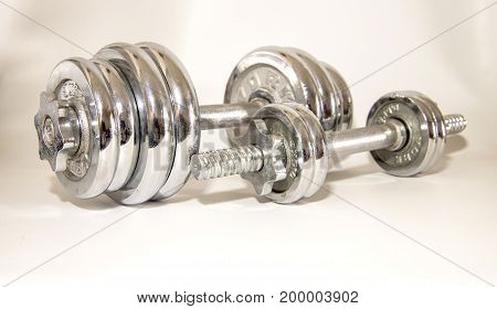 a Dumbbell fitness on white background in studio