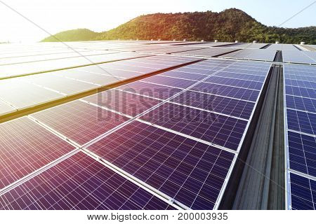 Solar PV Rooftop with Beautiful Sunlight and Mountain Background