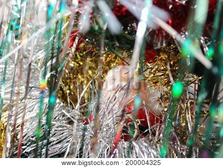 The figure of Santa Claus among tinsel