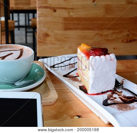 Relax Time,a Cup Of Coffee On Wooden Table  With Orange Cake