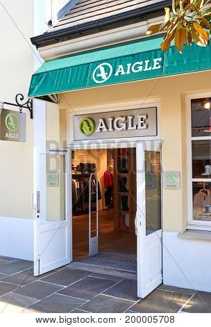 PARIS FRANCE - MAY 10 2017 : Aigle boutique in La Vallee Village. Aigle is a French footwear and textile company founded in 1853 as the Compagnie du Caoutchouc Souple