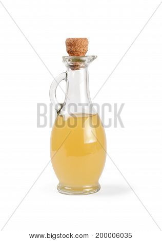 Decanter with apple vinegar isolated on the white background