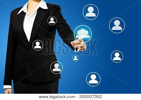 businesswoman hand pressing social network icon, networking concept