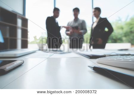 Colleagues discussing important business documents before they start to negotiate a deal