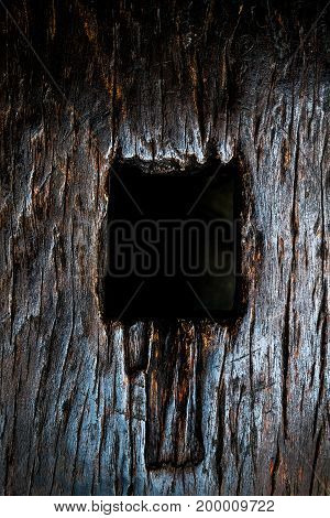 Weathered obsolete cracked textured wooden grunge and aperture background