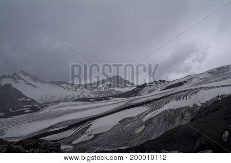 Lifeless rocky snow-covered mountains view from the of Elbrus North Caucasus Russia.