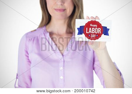 Portrait of beautiful businesswoman showing blank sign against happy labor day text in banner
