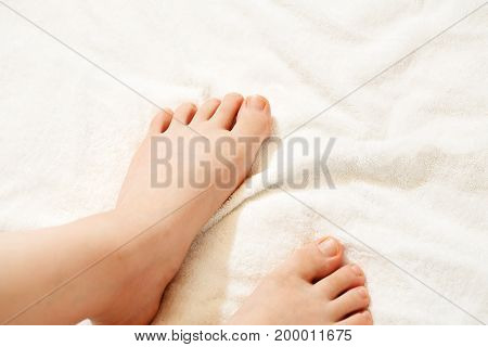 Beautiful woman's legs on white Blanket background