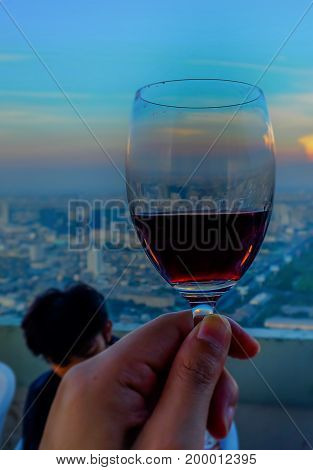 view from high building megapolis Bangkok city view on sunset with dinner Thailand