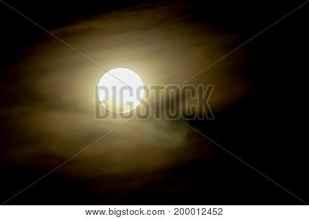 Full moon on dark sky with mist black background horror