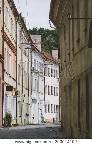 Narrow empty street in old town of Kaunas city Lithuania