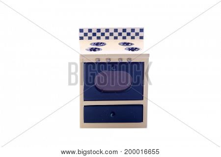 doll house furniture. miniature oven for a doll house. isolated on white. room for text