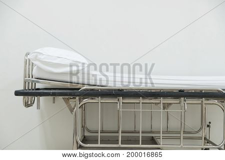 Empty Stretcher Trolley Or Hospital Trolley For Patient With White Room.