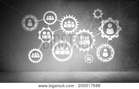 White icons of social gear mechanism presented against grey wall on background.