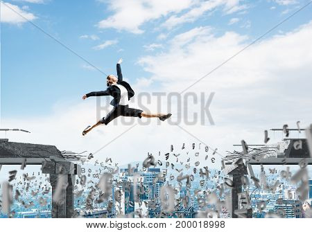 Business woman jumping over gap with flying letters in concrete bridge as symbol of overcoming challenges. Cityscape on background. 3D rendering.