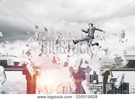 Businessman jumping over gap with flying paper documents in concrete bridge as symbol of overcoming challenges. Sunlight and cityscape on background. 3D rendering.
