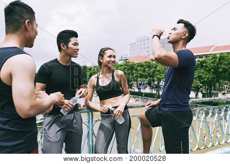Joggers having break for fresh water after training