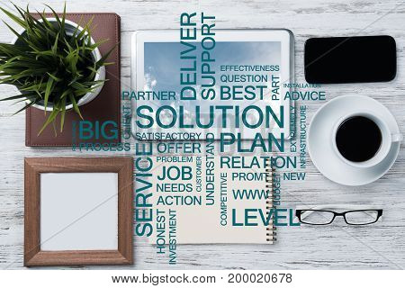 Top view of modern workplace with office stuff and business-related terms above presenting still office life