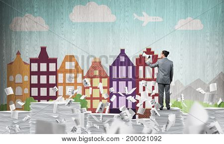 Businessman in suit standing among flying documents with speaker in hand with sketched cityscape view on background. Mixed media.