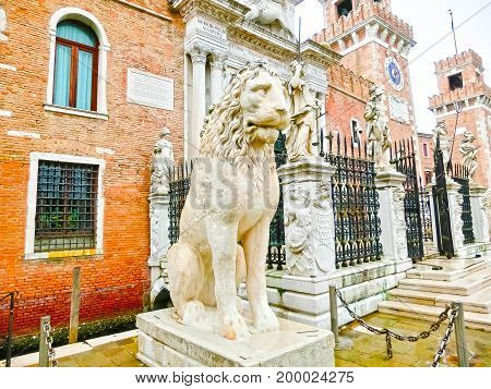 The sculptures at entrance of the Arsenale. Venice, Italy