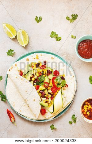 Delicious vegan tacos on rustic background.  Top view, lots of copy space