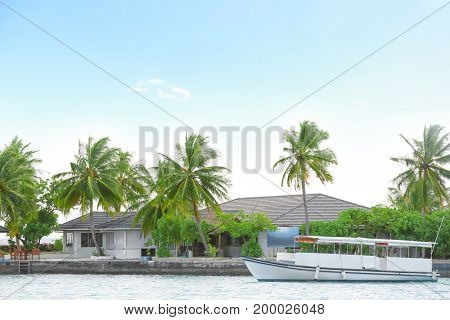 Berth with modern boat at tropical resort