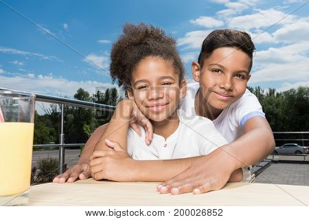 view of adorable african-american kids embracing outdoors