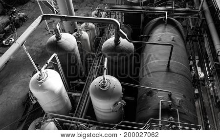 Electric power plant machinery and piping black and white